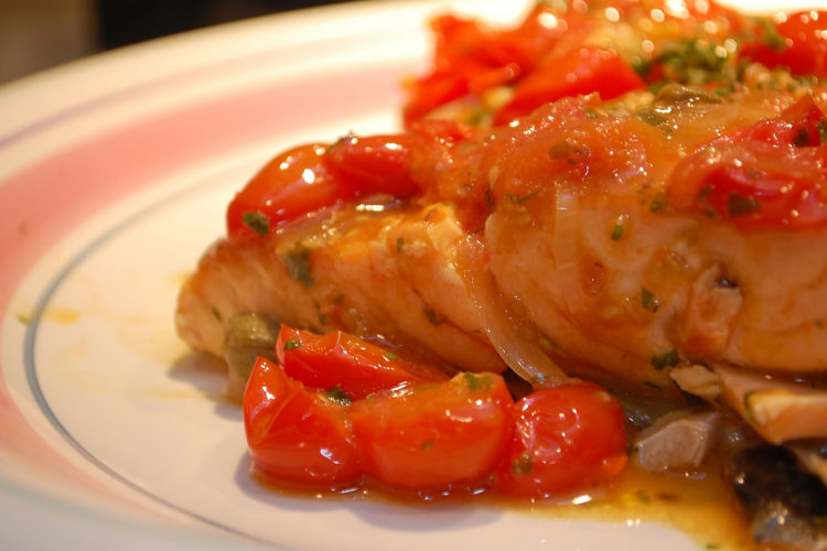 Curry Crusted Wild Salmon filet with roasted cherry tomatoes and zucchini